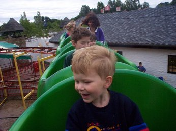 Picture of children enjoying one of the rides at Camelot
